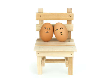 lean out: Lover eggs couple, lean on each other on wooden chair, isolated on white background