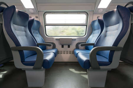 facing each other: Four empty blue seats facing each other in modern European train