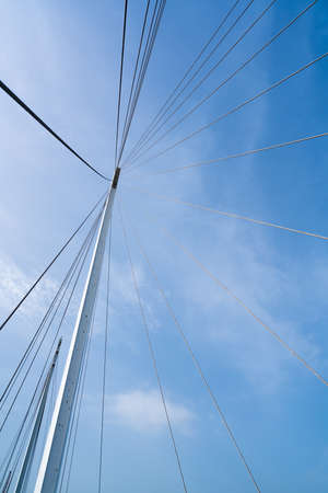 architectural firm: Bridge architecture, pylon and steel cables structure, clear blue sky background