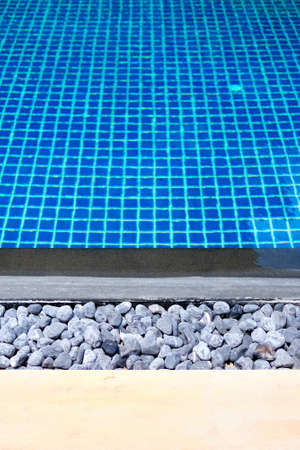 vertical orientation: Background image of swimming pool with grid pattern ceramic tiled floor, vertical orientation suitable for phone
