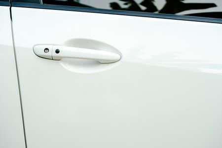 door handle: Car door handle on drivers door of modern white car