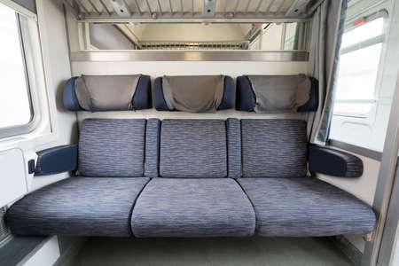 adjacent: Three adjacent empty seats on modern European train