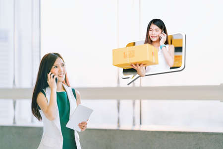 Beautiful girl shop using smartphone and cute female small business owner in chat speech bubble deliver parcel box. Ecommerce communication, shipping commercial, SME sale promotion advertise concept Stock Photo