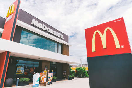 Bangkok, Thailand - May 24, 2018: McDonald's logo and exterior at 24 hours open branch, day time scene, editorial photo. McDonald's is the world's largest global chain business of fast food restaurant
