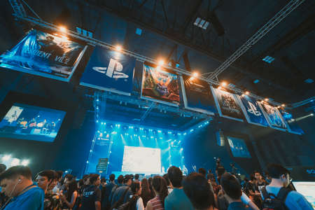 Bangkok, Thailand - Aug 18, 2018: Crowd of gamer attending stage show event of PlayStation Experience SEA (South East Asia) 2018, video game demo exhibition held for the first time in Bangkok Thailand 報道画像