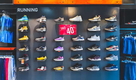 Bangkok, Thailand - Sep 11, 2018: Nike running shoes and sports clothing on 40% promotion price discount shelf at Nike outlet store