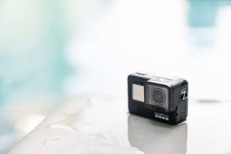 Bangkok, Thailand - Sep 28, 2018: New GoPro Hero 7 Black action camera on wet surface at swimming pool with copy space. Illustrative editorial content