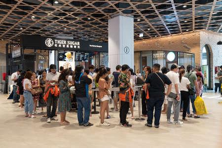 Bangkok, Thailand - Apr 28, 2019: People queueing at Tiger Sugar bubble tea shop, a new Taiwanese beverage store newly opening in The Market Bangkok