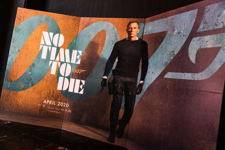 Bangkok, Thailand - Dec 20, 2019: James Bond 007 No Time To Die movies advertising on backdrop poster standee in cinema theatre. Movie advertisement or film entertainment industry concept