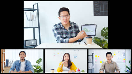 Group on young Asian business people, office coworkers on video online conference call, remote team meeting collage screen. New normal social distancing lifestyle, work from home concept Imagens