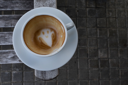 Coffee Art fot the Halloween as a smile ghost