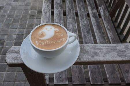 ghost: Coffee Art fot the Halloween as a smile ghost