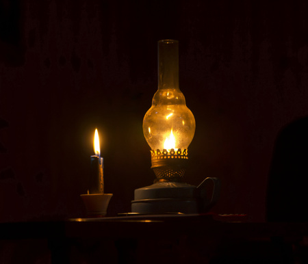 kerosene lamp and candles flicker in the dark warm light