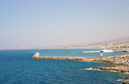 beautiful amazing views from the cliff on the blue azure sea and the port on the island of Crete in Greece Stock Photo