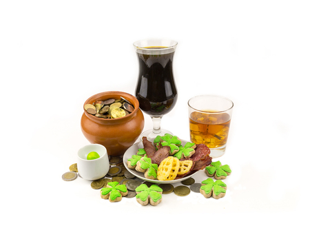 gratuity: Celebration of St. Patricks Day with a dark beer whiskey appetizers and a pot of scattered coins and clover