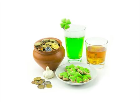 gratuity: Pot of coins whiskey scotch green beer clover garlic on white background. St.Patrick s Day