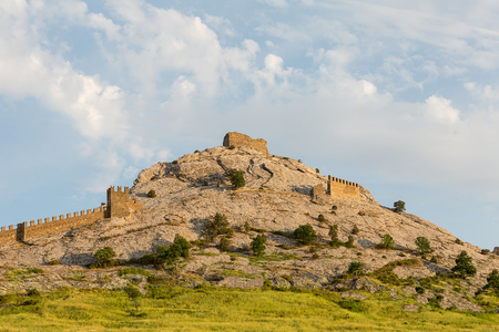 Crimea Sudak high mountain part of the fortification of the old fortress against the blue sky background