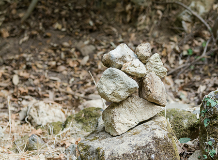 grey pattern: Pyramid of stacked rectangular gray uneven stones balancing on one harmonious peace Stock Photo