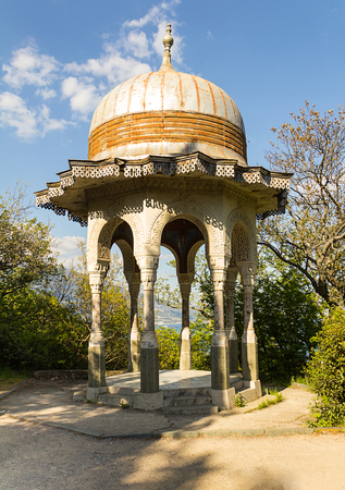 Open graceful stone gazebo pavilion with carved walls and a round roof- Yalta Crimea