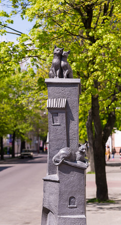Belarus, Brest - Sculptural composition two cats on the roof of the house third on lies below - the name Old Town May 2016 Editorial