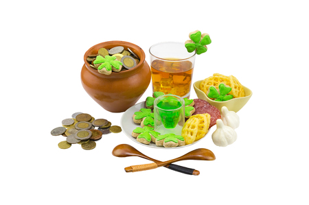 gratuity: glass of whiskey for a dessert green liquor a festive table decorated with garlic and appetizers and coins. Saint Patrick�s Day