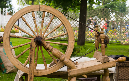 Old wooden worker spinning wheel traditional tools of seamstresses in the Middle Ages