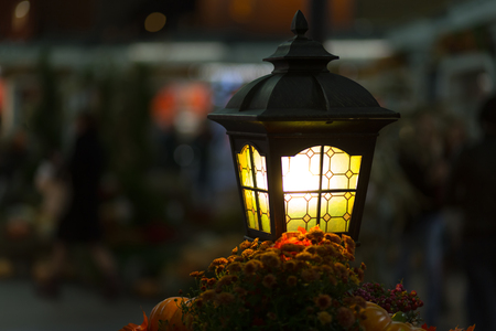 glows: close-up  yellow lantern glows yellow. street lighting. Creating cozy romance  bright lamp with copyspace on  blurred background