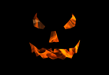 halloween background lantern jack, terrible face texture of fire on a black base