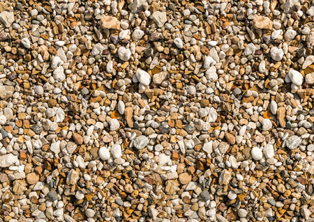 background stone small pebble beige brown natural texture, sea beach Imagens
