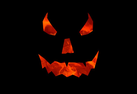 burning smile on black background, ominous pumpkin background halloween jack o lantern