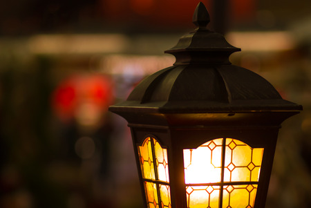 street lamp close-up with copyspace. Magic lamp with a warm yellow light in the city twilight