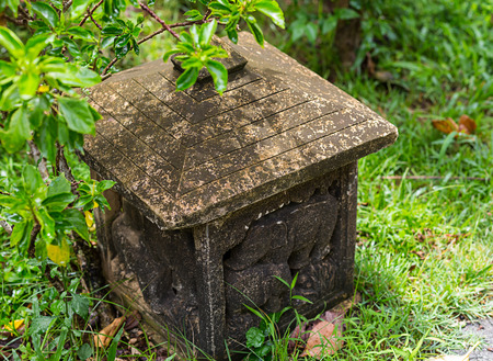 stone lamp asia, square house with carved walls ornament traditional elephant, old covered with moss Reklamní fotografie