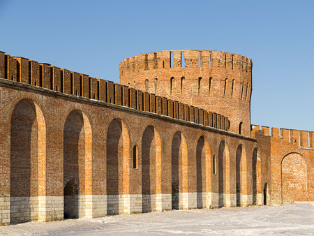 Arched wall old fort brick Russian city round big tower with a crenellated roof. Smolensk, Russia,