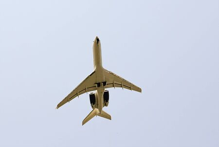white passenger plane Tu-154 flies high in the sky, a flying machine in the air comes to land. Russia, Sochi July 2011 에디토리얼