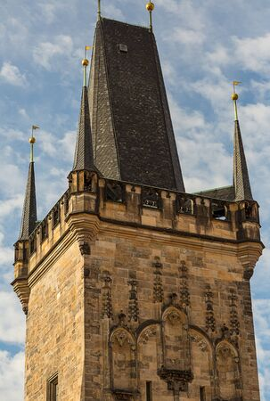 bridge tower  Charles Bridge. Little tower of Malostranskaya on a background of blue sky close-up. Czech Republic Prague February 2017 에디토리얼