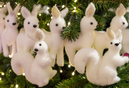 row of white deer many figures and two proteins with black eyes decoration Christmas Stock Photo
