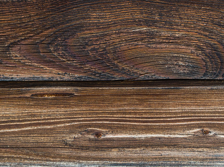two dark brown weathered effect of a scorched wood parallel board dark base background