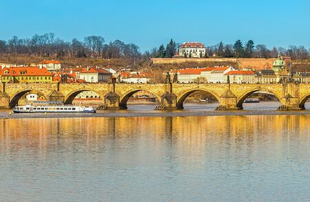 Prague panoramic view of the bridge of the carla river vltava ships in the background of the hill and old houses. Czech Republic Prague March 2017 에디토리얼