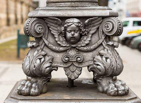 sculpture lantern cupid decoration element metal ornament close-up.Prague Czech Republic 2017