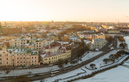 Vyborg panorama of the city in winter from a height, a snow roof house and a frozen river. Russia Vyborg January 2016