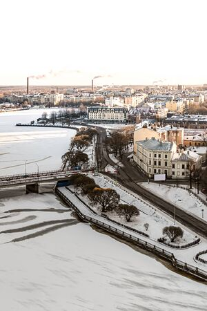 winter city houses an ancient square contrasted with a modern background along the snow-covered frozen river peninsula panorama view of Vyborg. Russia Vyborg January 2017 에디토리얼