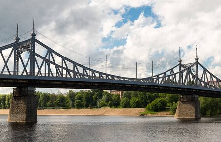 metal bridge river Volga on a background of sandy beach center of Tver. Russian Federation city of Tver July 2017 에디토리얼