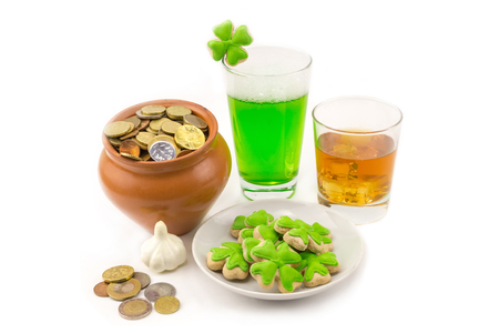 glass of bright beer green with clover glass of whiskey golden drink with ice and clay pot with coins luck treasure celebration of the day saint