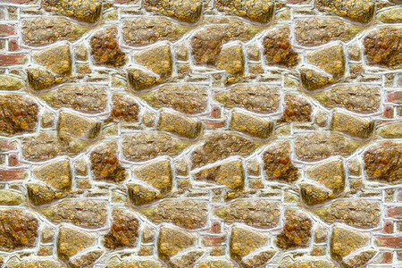 panel light beige brown stones uneven folded wall uneven carved urban background 스톡 콘텐츠