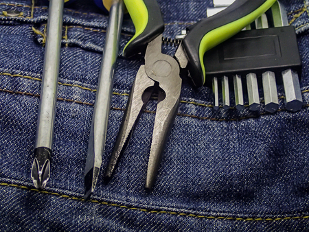 cross flat knife screwdriver set hexagon spanner on background dark blue linen denim background industrial house renovation 版權商用圖片