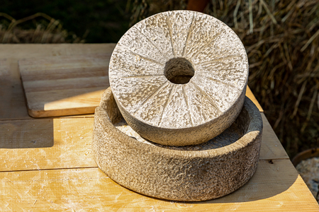 millstone stone grain grinding flour production handmade traditional way with antiquity