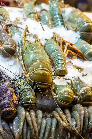 sea food in ice large lobster royal prawns close-up asian market street many seafood delicacies thailand vietnam Фото со стока