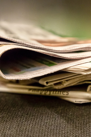 stack of newspapers paper edition news source sports events life of secular people gossip background design Stock fotó