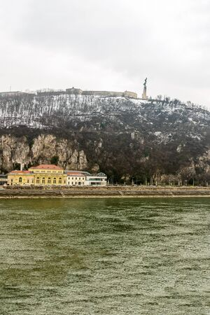 View of the Danube River with Mount Gellert and Citadel of the ancient building of the monument of freedom Budapest. Hungary Budapest 24 February 2018 에디토리얼