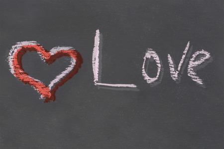 red heart Love chalk inscription handmade on black slate board design art festive base